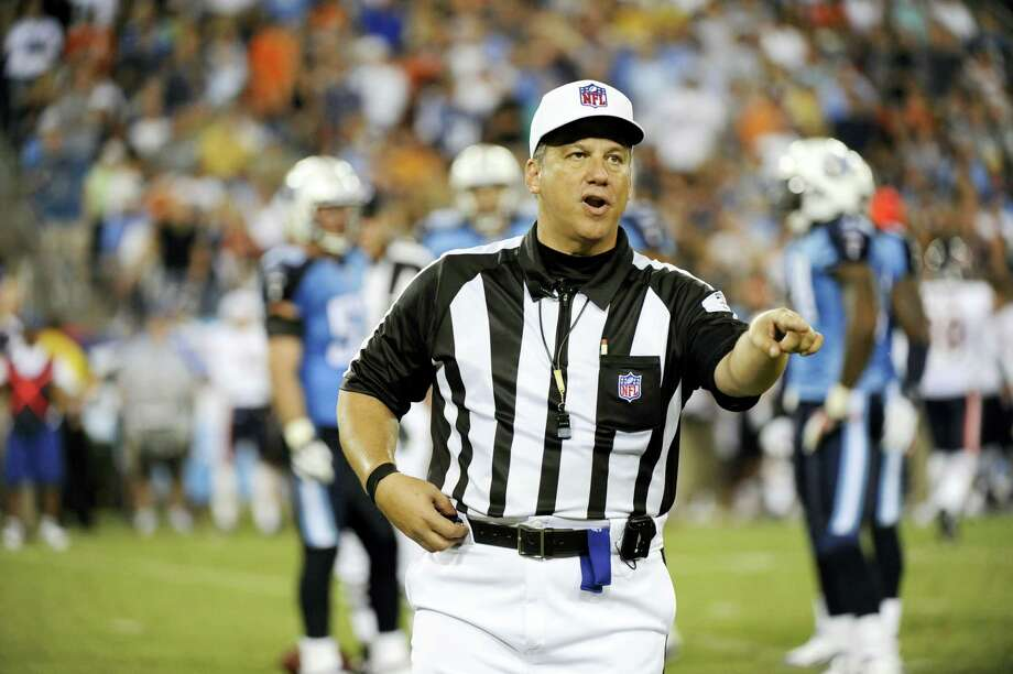 In this Aug. 27, 2011 photo, referee Alberto Riveron makes a call in the second quarter of an NFL football preseason game between the Chicago Bears and the Tennessee Titans in Nashville, Tenn. The NFL has promoted Riveron to its head of officiating. A nine-year game official and former referee, Riveron was born in Cuba. Photo: AP Photo — Frederick Breedon, File  / FR159542 AP