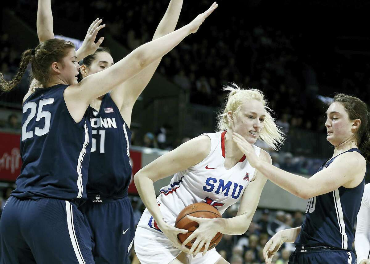 SMU guard Stephanie Collins (15) battles UConn's Kyla Irwin (25), Natalie Butler (51) and Molly Bent during Saturday's game.