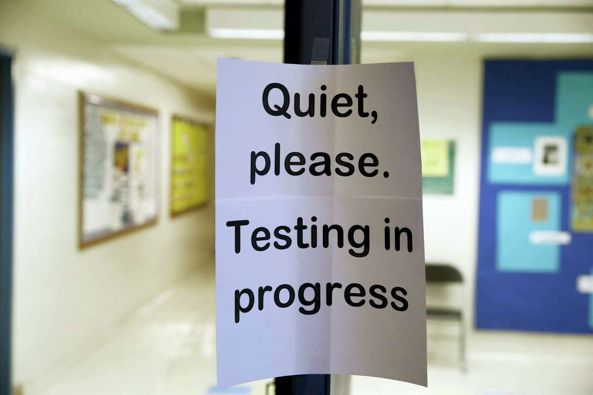 In this Jan. 17, 2016 photo, a sign is seen at the entrance to a hall for a college test preparation class in Bethesda, Md. The $380 million test coaching industry is facing competition from free or low-cost alternatives in what their founders hope will make the process of applying to college more equitable.