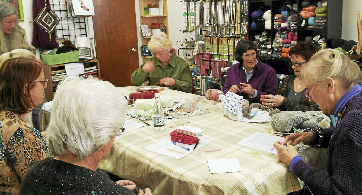 A group of knitters enjoy a Sunday Sit & Knit at In Sheep's Clothing in Torrington.