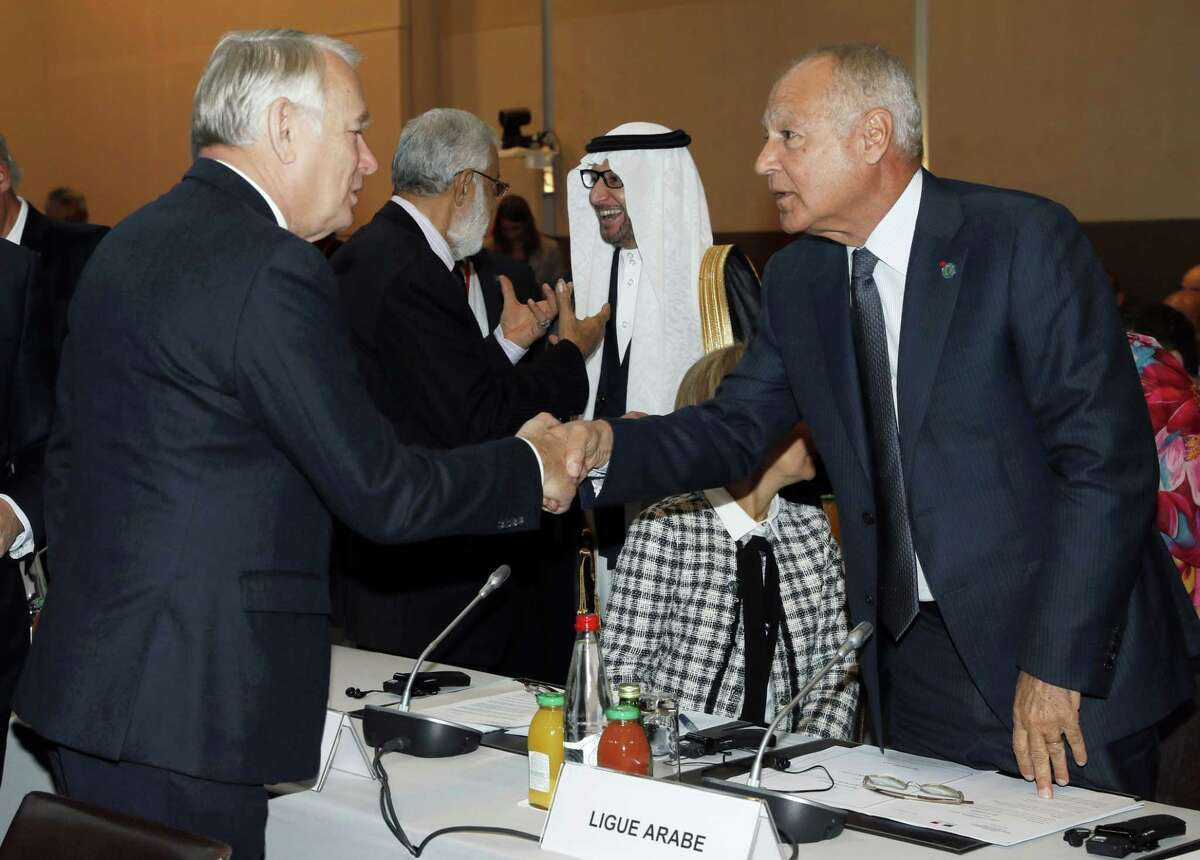 French Minister of Foreign Affairs Jean-Marc Ayrault, left, shakes hands with Arab League Secretary General Ahmed Aboul-Gheit at the opening of the Mideast peace conference in Paris on Jan. 15, 2017. Fearing a new eruption of violence in the Middle East, more than 70 world diplomats gathered in Paris on Sunday to push for renewed peace talks that would lead to a Palestinian state.