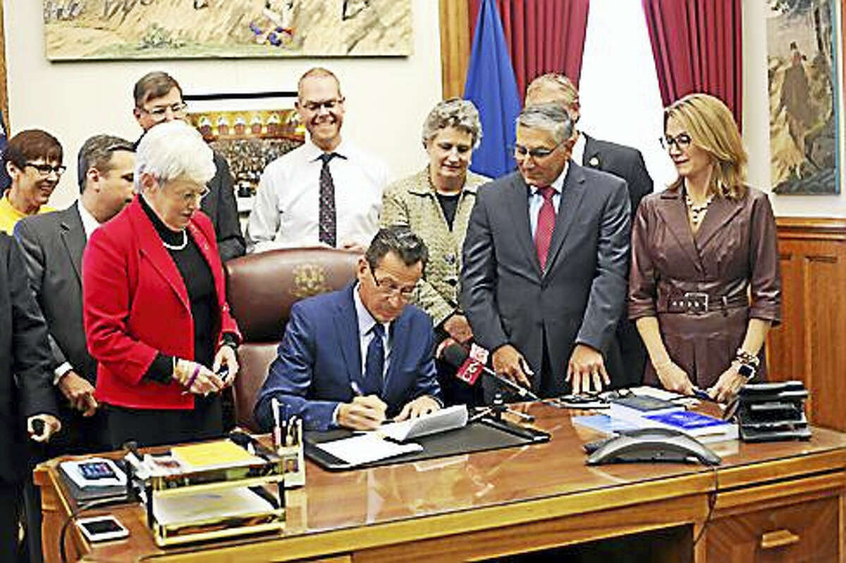 Connecticut Governor Dannel Malloy signs the conversion therapy bill into law on May 10, 2017.
