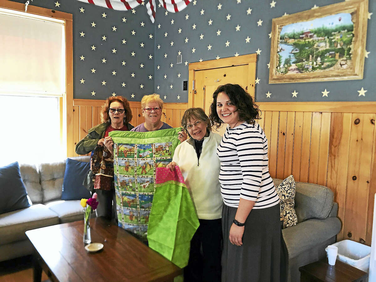 Hearthside Quilters Guild members brought 208 pillowcases and eight quilts, all handmade by members, to the Hole in the Wall Gang camp in Ashford.