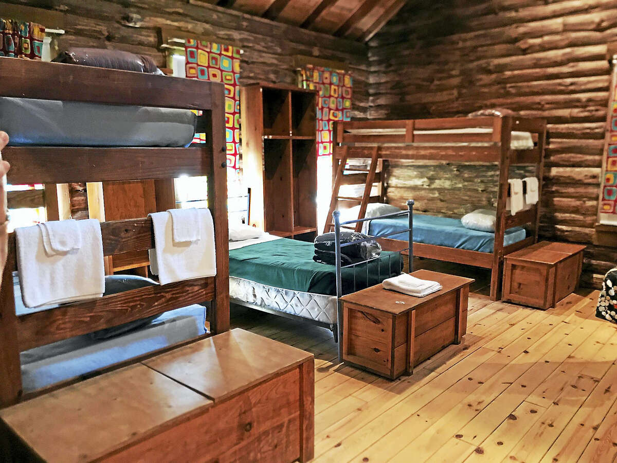 Quilts are displayed at cabin at the Hole in the Wall camp.