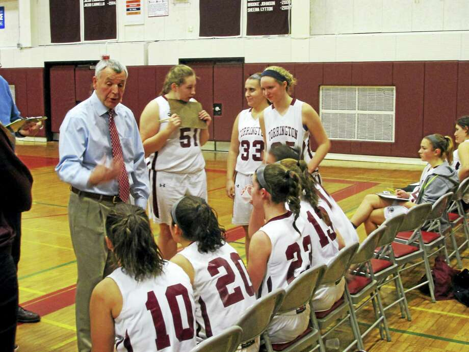 Torrington coach Mike Fritch talks to his players during Friday night's win over Woodland. Photo: Photo By Peter Wallace