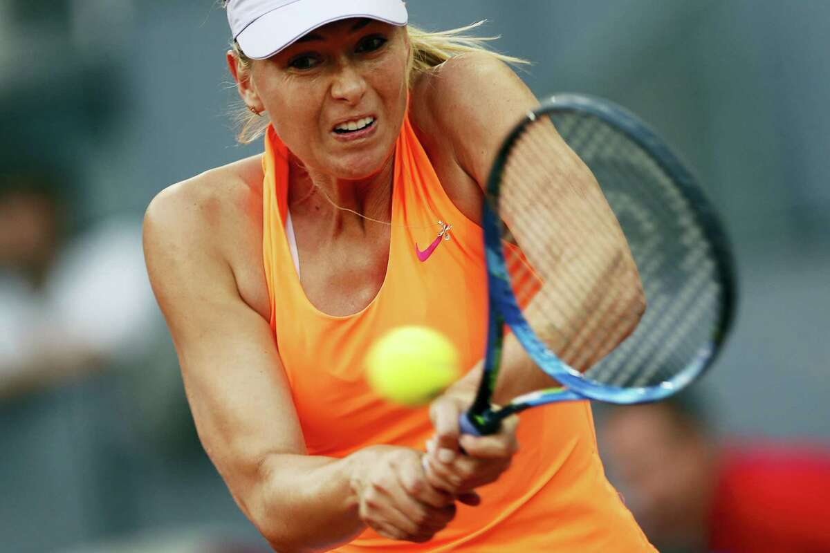 Maria Sharapova from Russia returns a ball to Eugenie Bouchard from Canada during a Madrid Open tennis tournament match in Madrid, Spain on May 8, 2017. Bouchard won 7-5, 2-6 and 6-4.