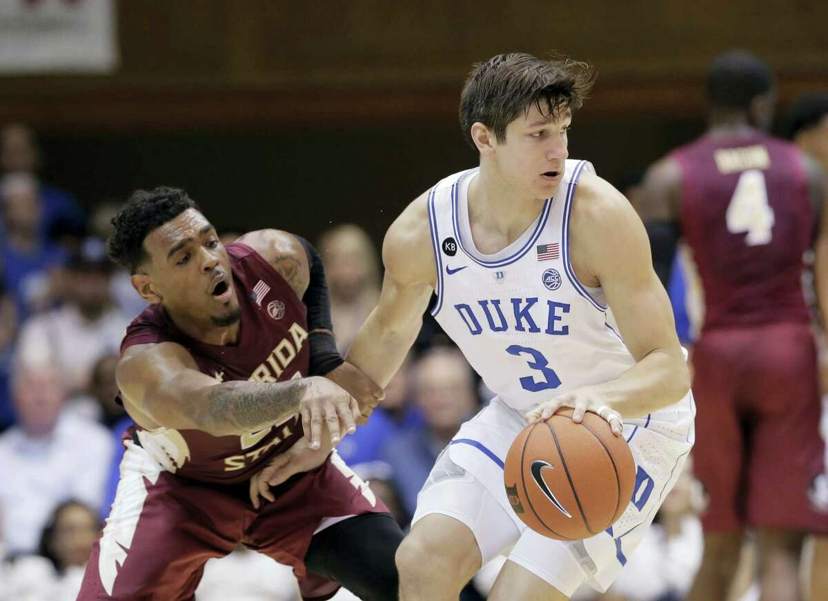 Duke's Grayson Allen (3) dribbles while Florida State's Xavier Rathan-Mayes defends during the first half of an NCAA college basketball game in Durham, N.C. on Feb. 28, 2017.