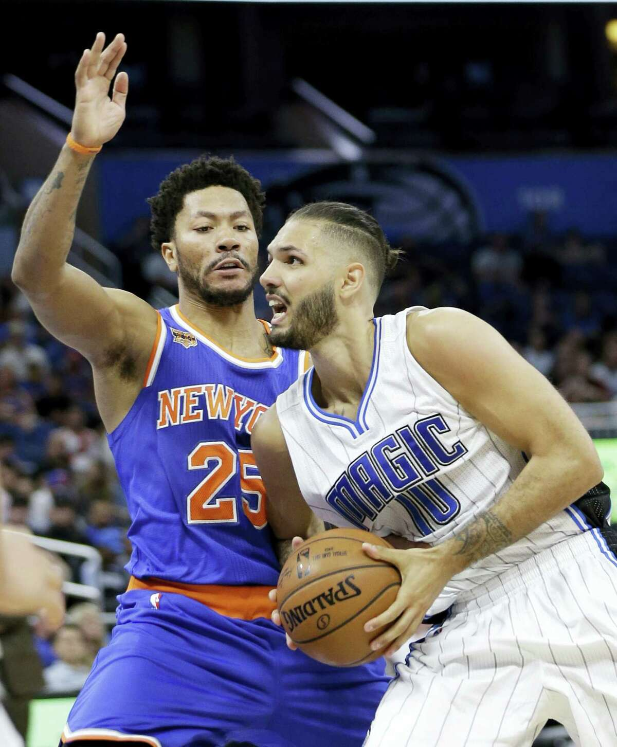 Orlando Magic's Evan Fournier (10) goes to the basket against New York Knicks' Derrick Rose (25) during the second half of an NBA basketball game on March 1, 2017 in Orlando, Fla. New York won 101-90.