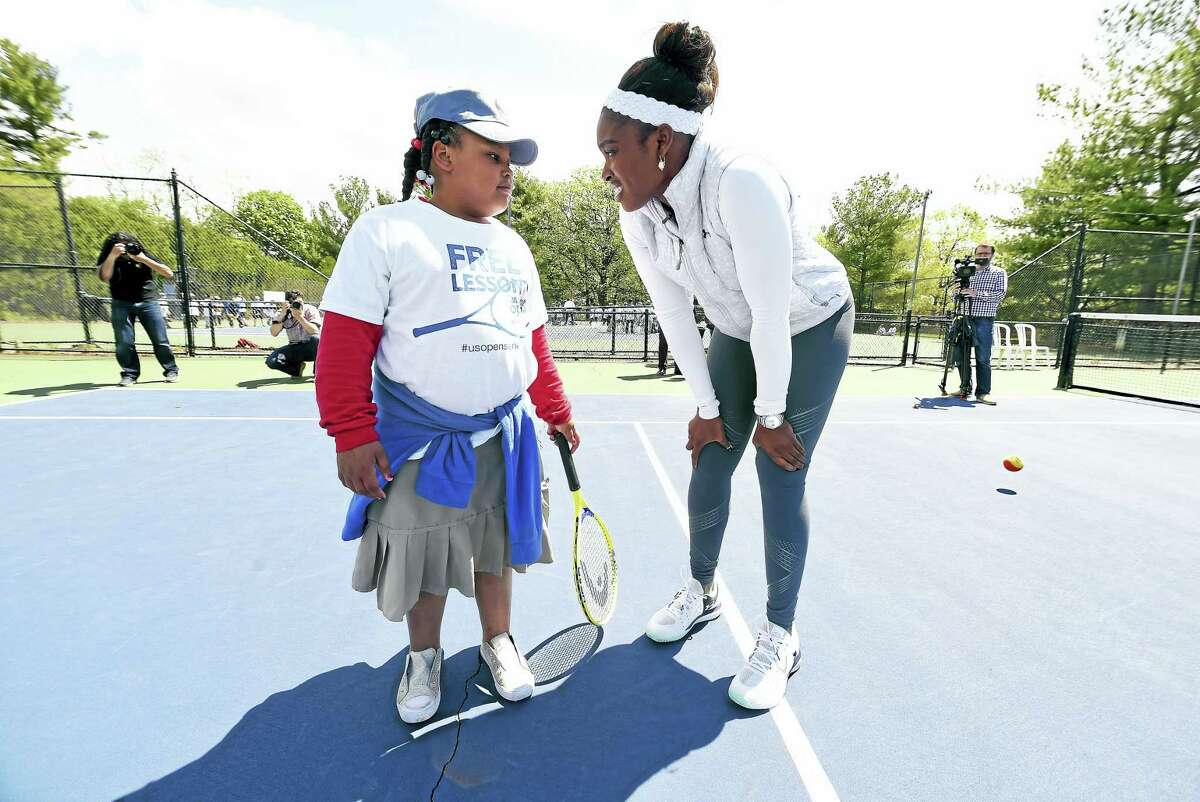 Arnold Gold — New Haven Register Mauro-Sheridan Magnet School third grader Mariyah Weston, 8, gets advice from tennis player Sloane Stephens during the clinic at the Connecticut Tennis Center.