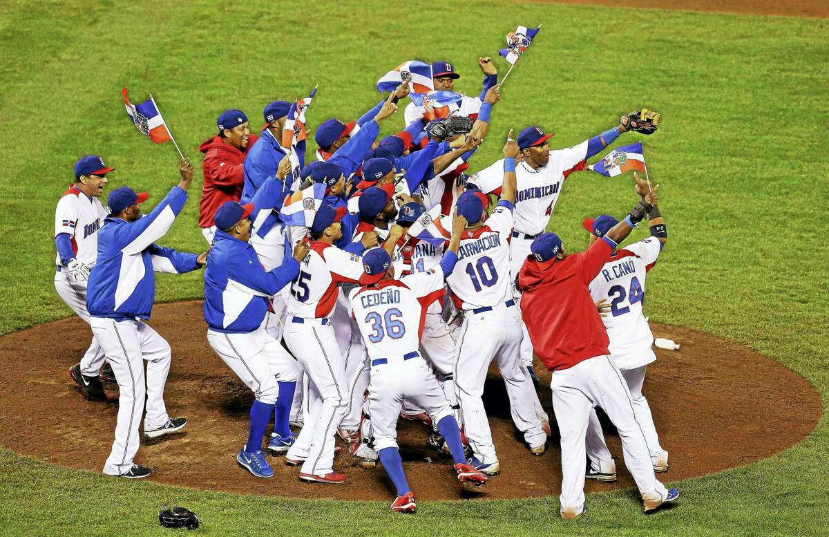 Players from the Dominican Republic celebrate after beating Puerto Rico in the championship game of the 2013 World Baseball Classic.