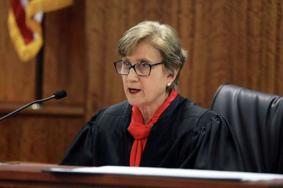 Citing legal precedent, Bristol County Superior Court Judge Susan Garsh vacates the first-degree murder conviction of Aaron Hernandez, Tuesday, May 9, 2017, in Fall River, Mass. Judge Garsh ruled Tuesday, that Former NFL star Aaron Hernandez's conviction in a 2013 murder can be erased because he died before his appeal was heard. Hernandez hanged himself in his prison cell last month while serving a life sentence on a first-degree murder conviction in the death of semi-professional football player Odin Lloyd. Photo: Pat Greenhouse/The Boston Globe Via AP, Pool   / Pool The Boston Globe