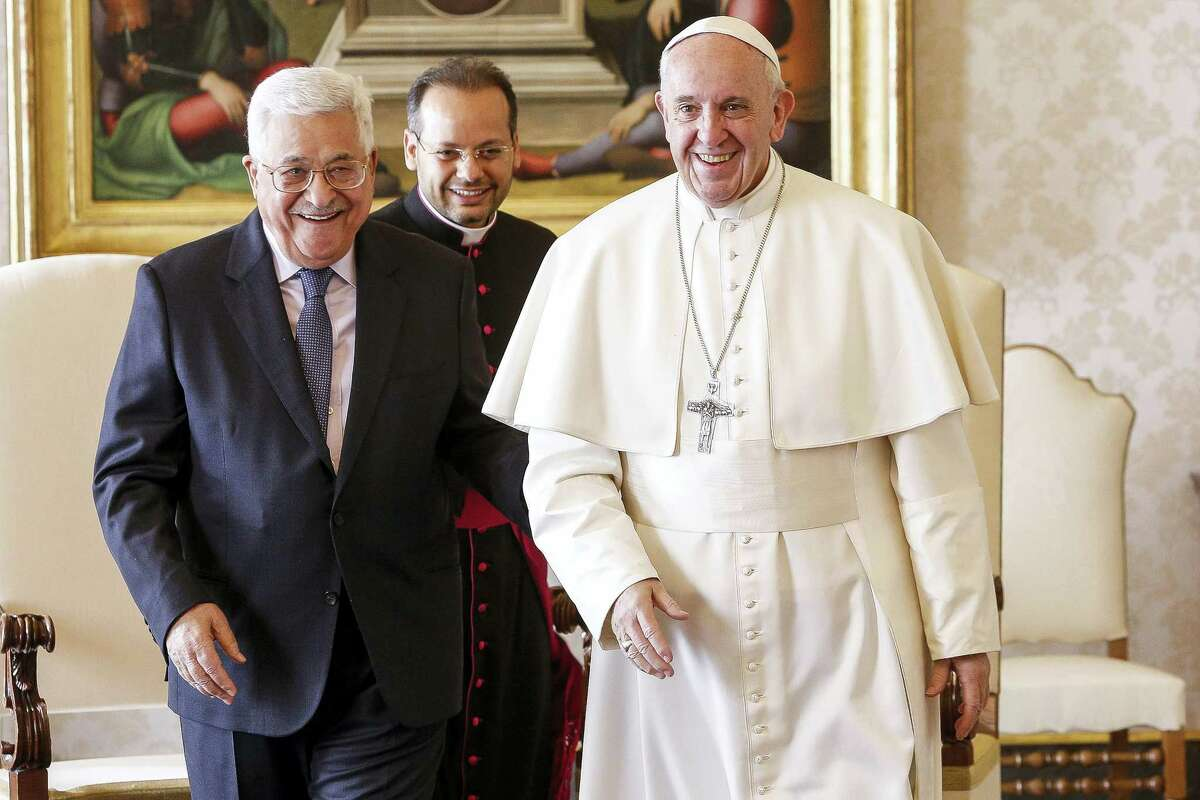 Pope Francis meets with Palestinian President Mahmoud Abbas during a private audience at the Vatican.