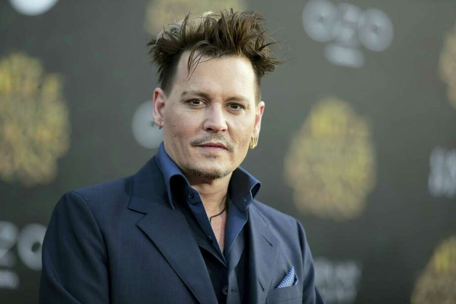 """In this May 23, 2016, file photo, Johnny Depp arrives at the premiere of """"Alice Through the Looking Glass"""" at the El Capitan Theatre, in Los Angeles. Johnny Depp is suing his former business managers alleging they mismanaged his earnings throughout his career, although the company says the actor'Äôs spending is to blame. Depp's lawsuit filed Friday, Jan. 13, 2017, in Los Angeles Superior Court against The Management Group seeks more than $25 million, alleging its owners failed to properly pay his taxes, made unauthorized loans and overpaid for security and other services, but the company's attorney says the managers tried for years to control Depp'Äôs spending. Photo: Photo By Richard Shotwell/Invision/AP, File   / Invision"""