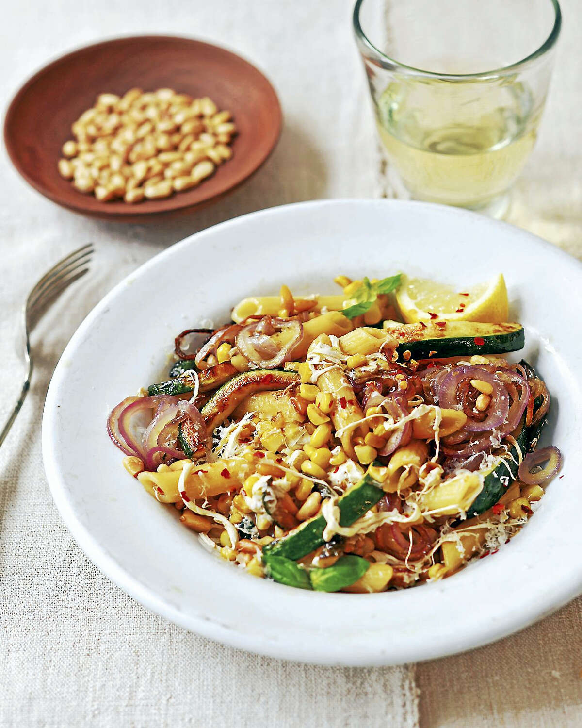 Zucchini, sweet corn and basil penne with pine nuts and mozzarella.