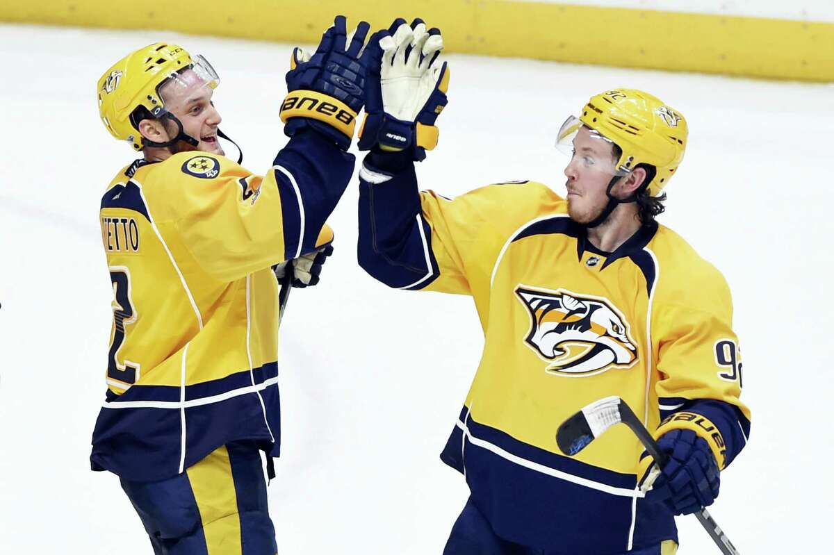 Nashville Predators defenseman Anthony Bitetto (2) and center Ryan Johansen (92) celebrate after beating the Boston Bruins 2-1 in an NHL hockey game Thursday.