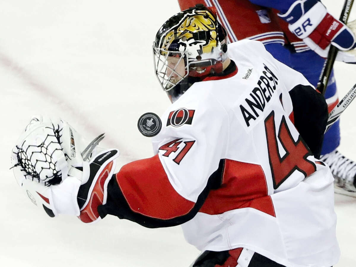 Ottawa Senators goalie Craig Anderson stops a shot on the goal from the New York Rangers during the third period of Game 6 of an NHL hockey Stanley Cup second-round playoff series Tuesday in New York. The Senators won 4-2, eliminating the Rangers.