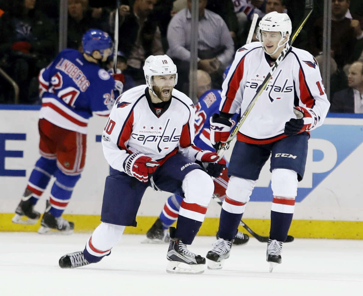 Washington Capitals' Brett Connolly (10) celebrates with teammate Jakub Vrana (13) after scoring a goal during the second period of an NHL hockey game as New York Rangers' Oscar Lindberg (24) skates away, Tuesday, Feb. 28, 2017, in New York. (AP Photo/Frank Franklin II)