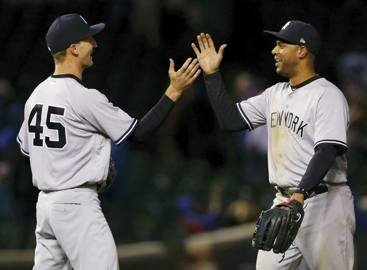 New York Yankees' Aaron Hicks, right, celebrates with relief pitcher Chasen Shreve after the Yankees defeated the Chicago Cubs, 5-4, after the 18th inning of an interleague baseball game on May 8, 2017 in Chicago.