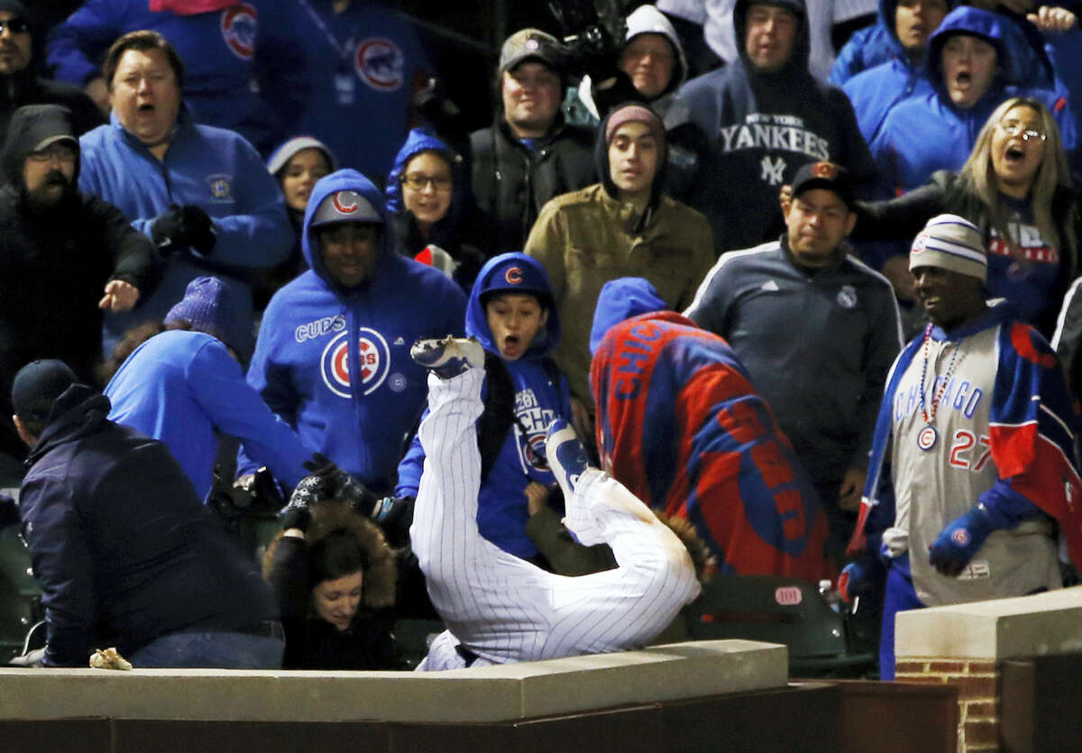 Chicago Cubs left fielder Kyle Schwarber catches a fly ball by New York Yankees' Chase Headley in foul territory during the 12th inning of an interleague baseball game Sunday, May 7, 2017 in Chicago.
