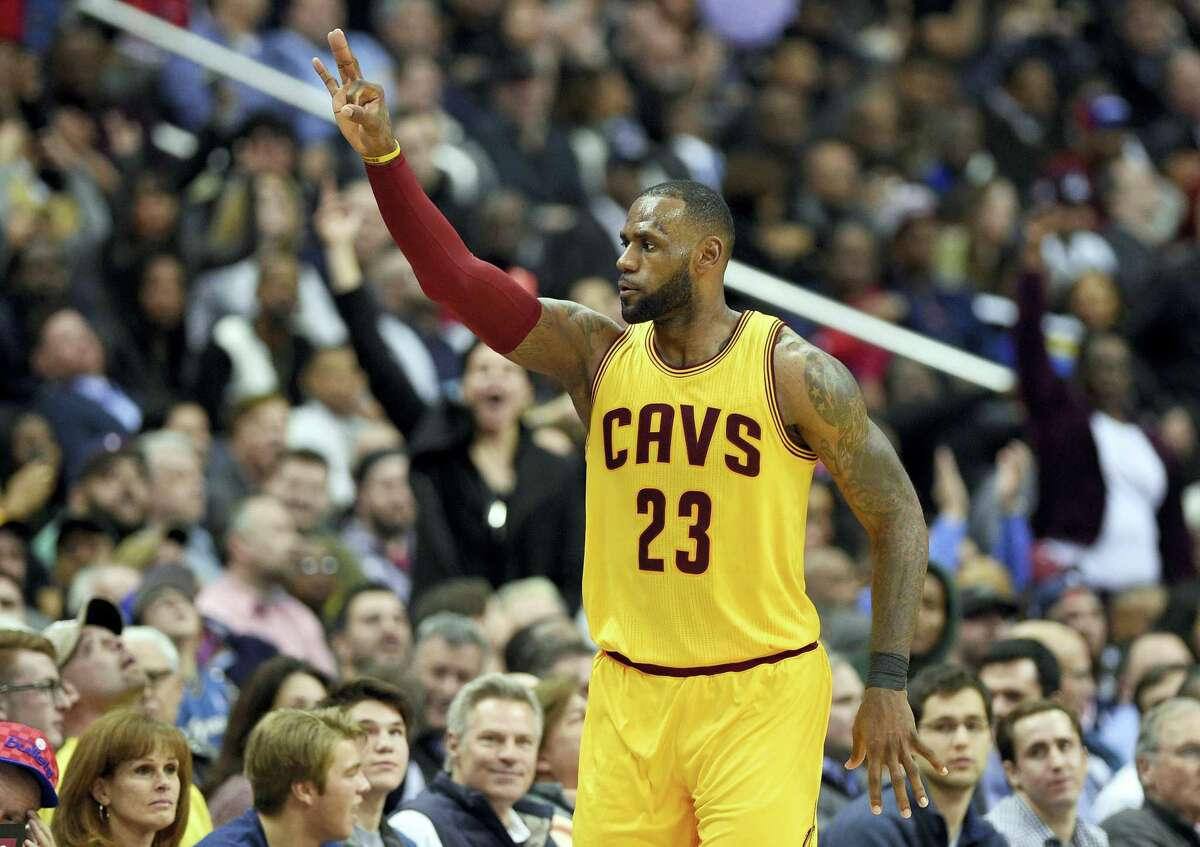 """In this Feb. 6, 2017 photo, Cleveland Cavaliers forward LeBron James gestures after he scored a basket during the second half of an NBA basketball game against the Washington Wizards in Washington. The Cavaliers got back to championship form in February. The NBA champions went 9-2, a nice turnaround after going 7-8 in January, when James called the team's roster """"top heavy"""" and asked for help."""