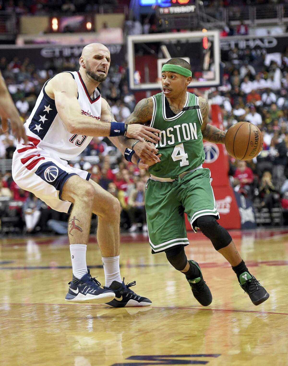Celtics guard Isaiah Thomas (4) dribbles against Wizards center Marcin Gortat during Game 4 on Sunday.