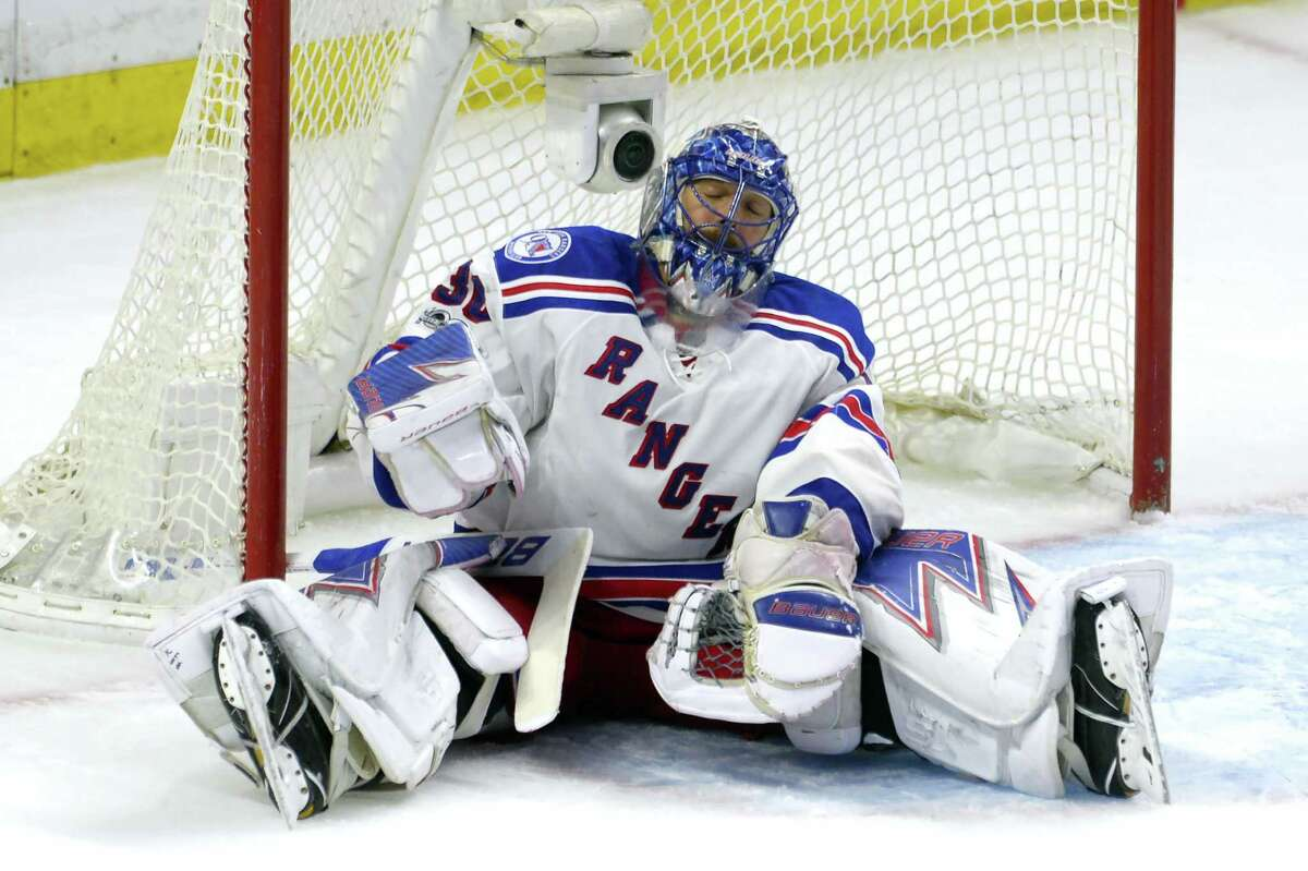 New York Rangers goalie Henrik Lundqvist reacts after surrendering a goal in Game 5.