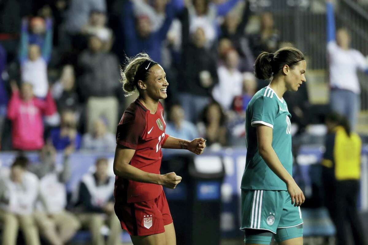 United States' Lynn Williams, left, celebrates near Germany's Dzsenifer Marozsan after Williams scored during the second half Wednesday in Chester, Pa.