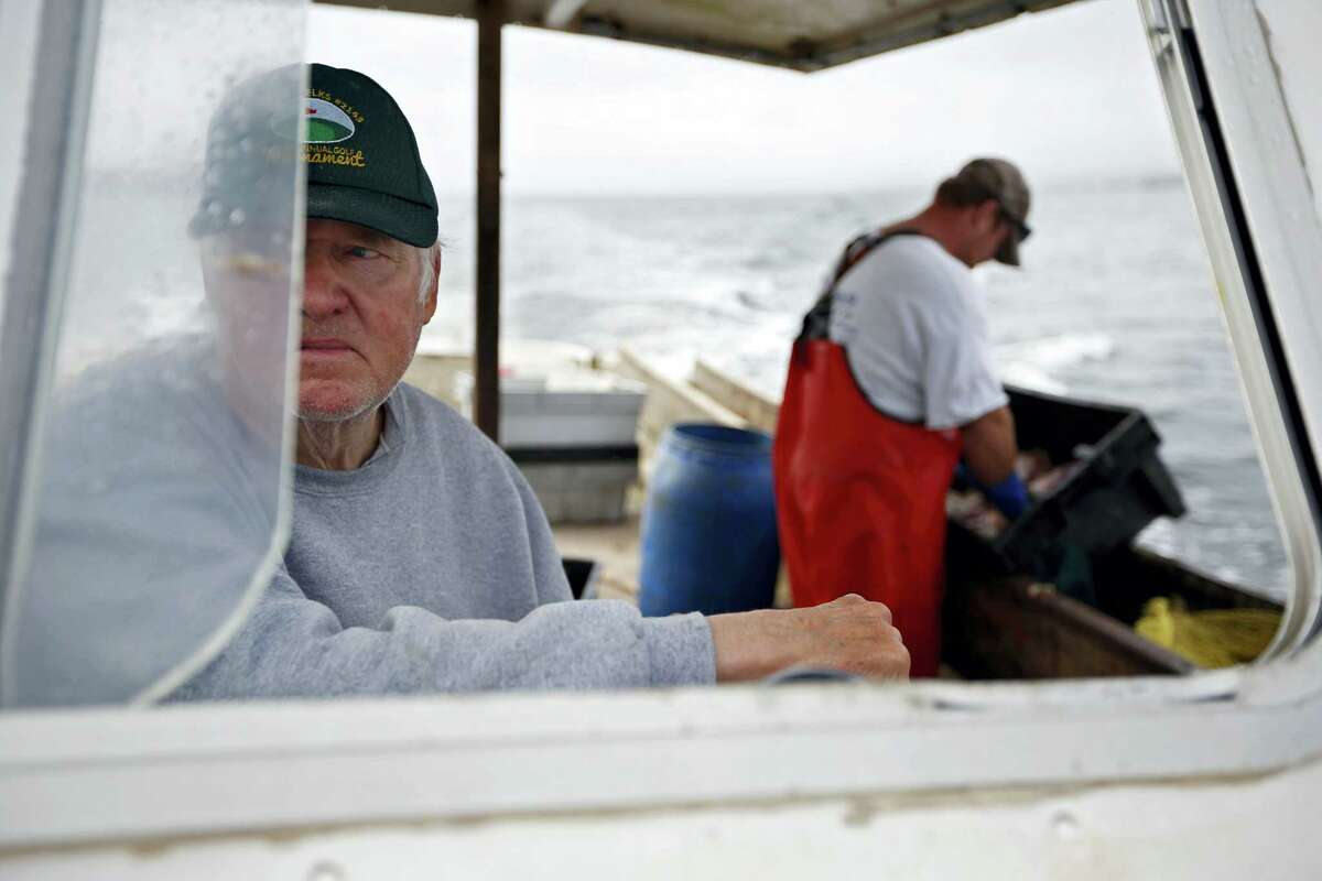 In this May 13, 2016 photo, Richard Sawyer, Jr. pilots his lobster boat in foggy weather on Long Island Sound off Groton, Conn. Sawyer is one of only a half-dozen lobstermen working in an area of the Sound that he says once had 75 lobstermen. A board of the Atlantic States Marine Fisheries Commission is scheduled to vote on new management measures on May 8, 2017 and Tuesday, May 9.