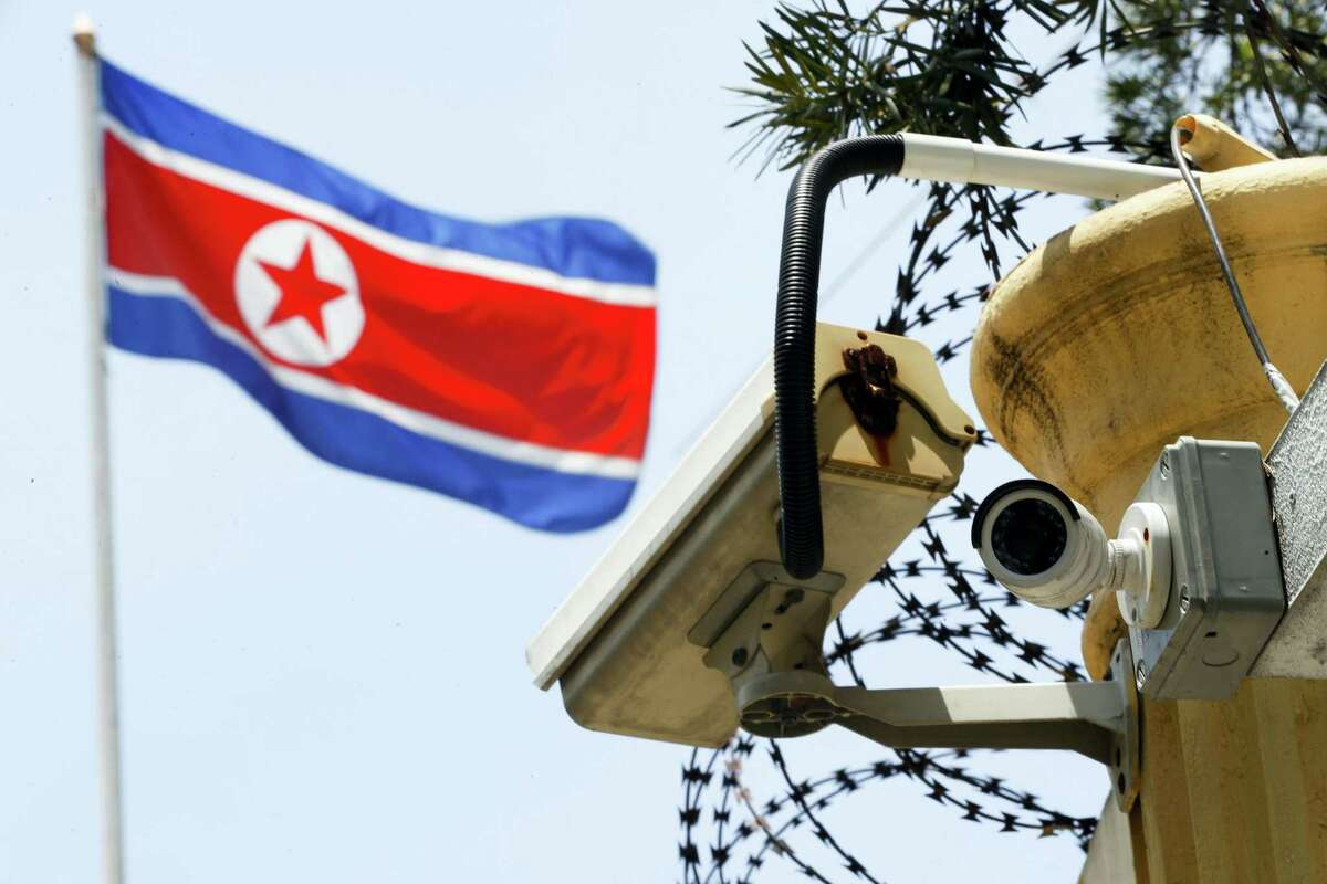 In this March 13, 2017 photo, a CCTV surveillance camera attached by the entrance gate at the North Korean Embassy monitors passersby in Kuala Lumpur, Malaysia.