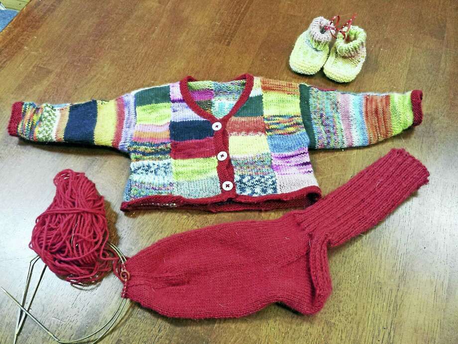 Socks and little sweaters like these give knitters a lot of joy. Photo: Contributed Photo