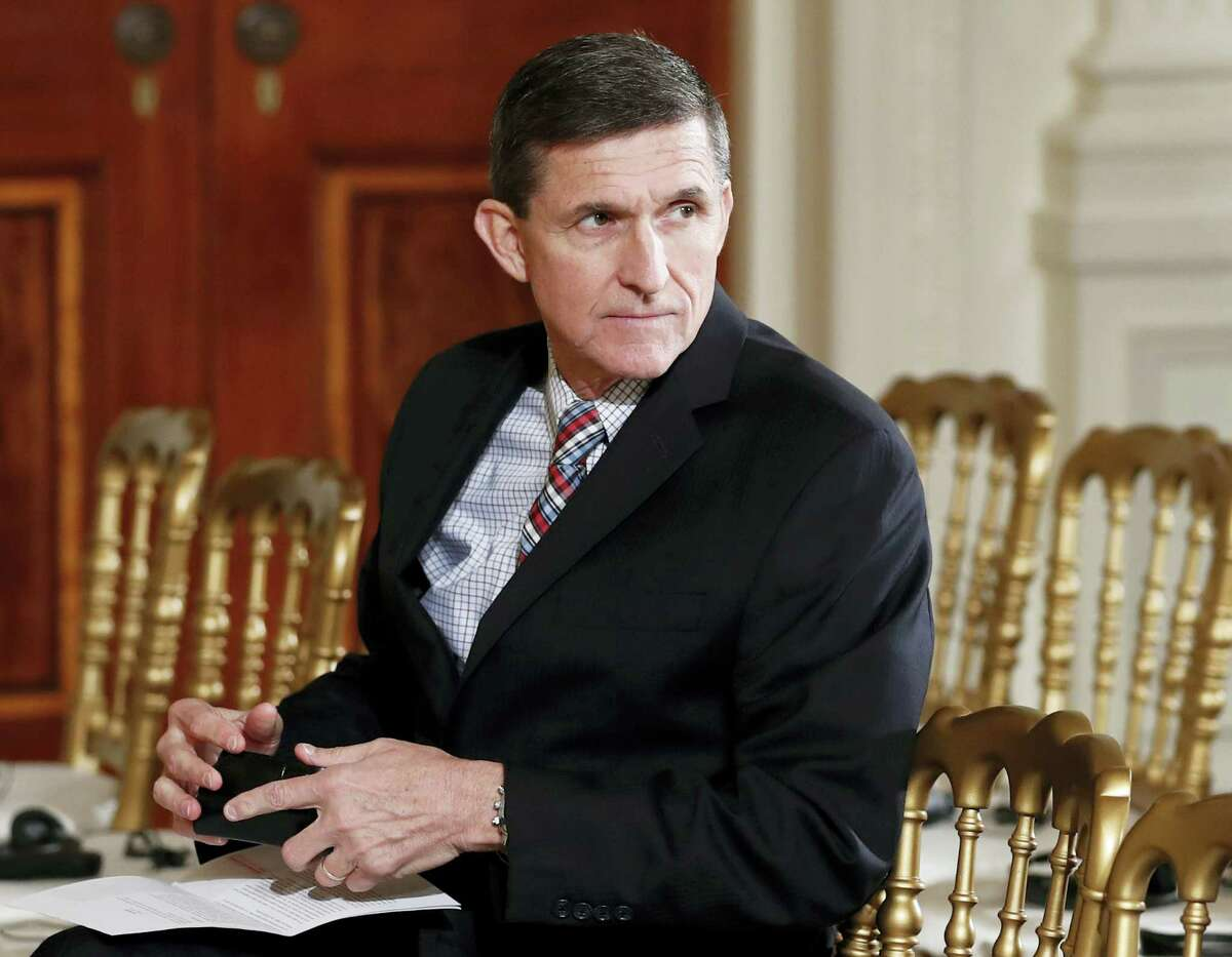 In this Feb. 10, 2017 photo, then-National Security Adviser Michael Flynn sits in the East Room of the White House in Washington. President Barack Obama warned Donald Trump against hiring Michael Flynn as national security adviser during an Oval Office meeting in the days after the 2016 election, according to three former Obama administration officials.