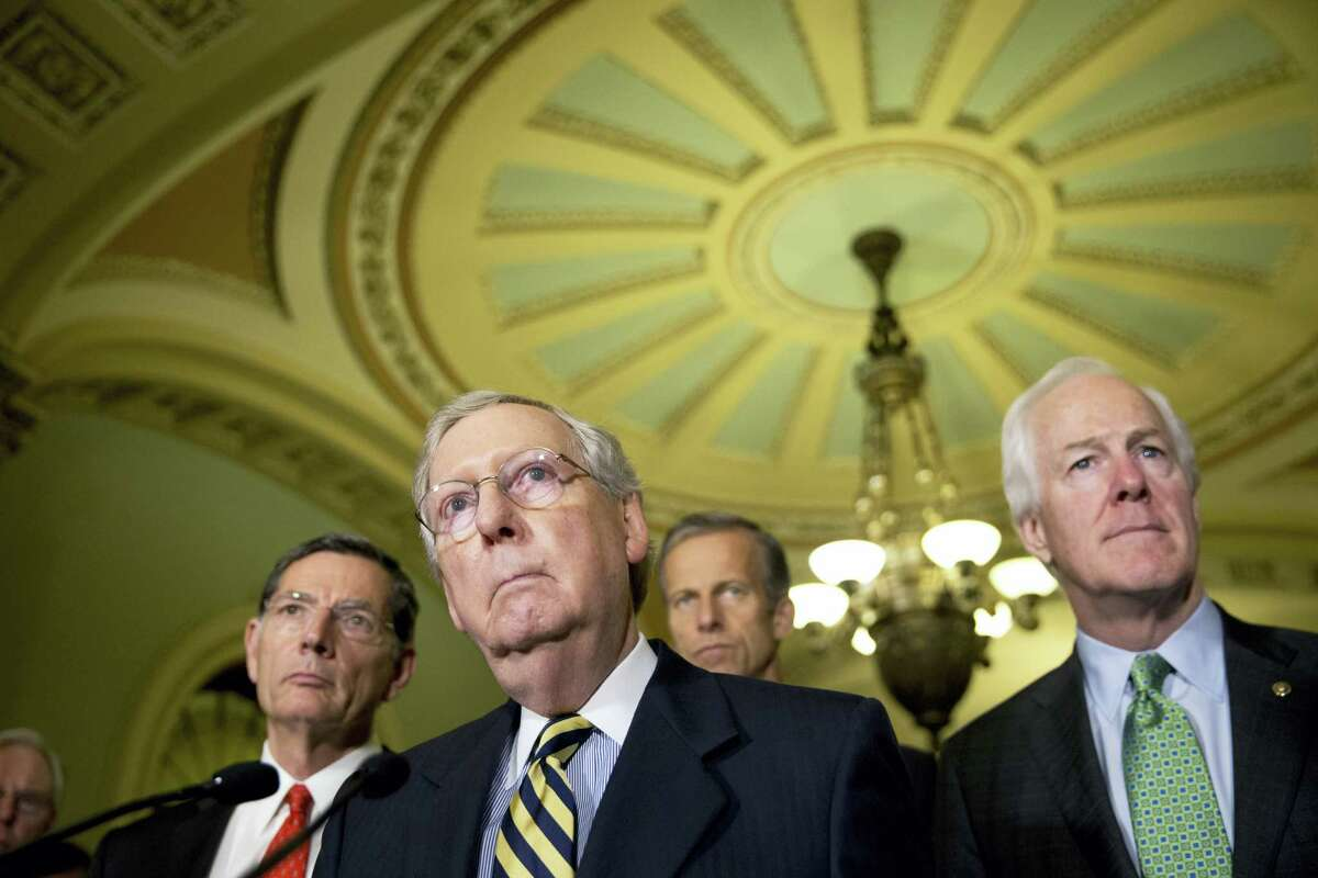 Senate Majority Leader Mitch McConnell accompanied by, from left, Sen. John Barrasso, R-Wyo., Sen. John Thune, R-S.D., and Senate Majority Whip John Cornyn of Texas, listen to a question during a news conference on Capitol Hill in Washington in 2016. Congressional Republicans are taking the first steps toward dismantling President Barack Obama's health care law, facing pressure from President-elect Donald Trump to move quickly on a replacement.