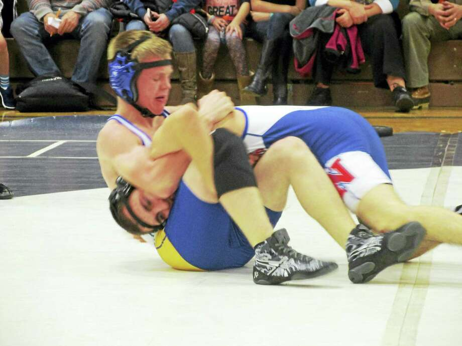 Gilbert's Charles Spear and Nonnewaug's Masen Williamson kicked off the high school matches at Nonnewaug Thursday after youth programs from the two areas showed off what's to come in the next few years. Photo: Peter Wallace - The Register Citizen