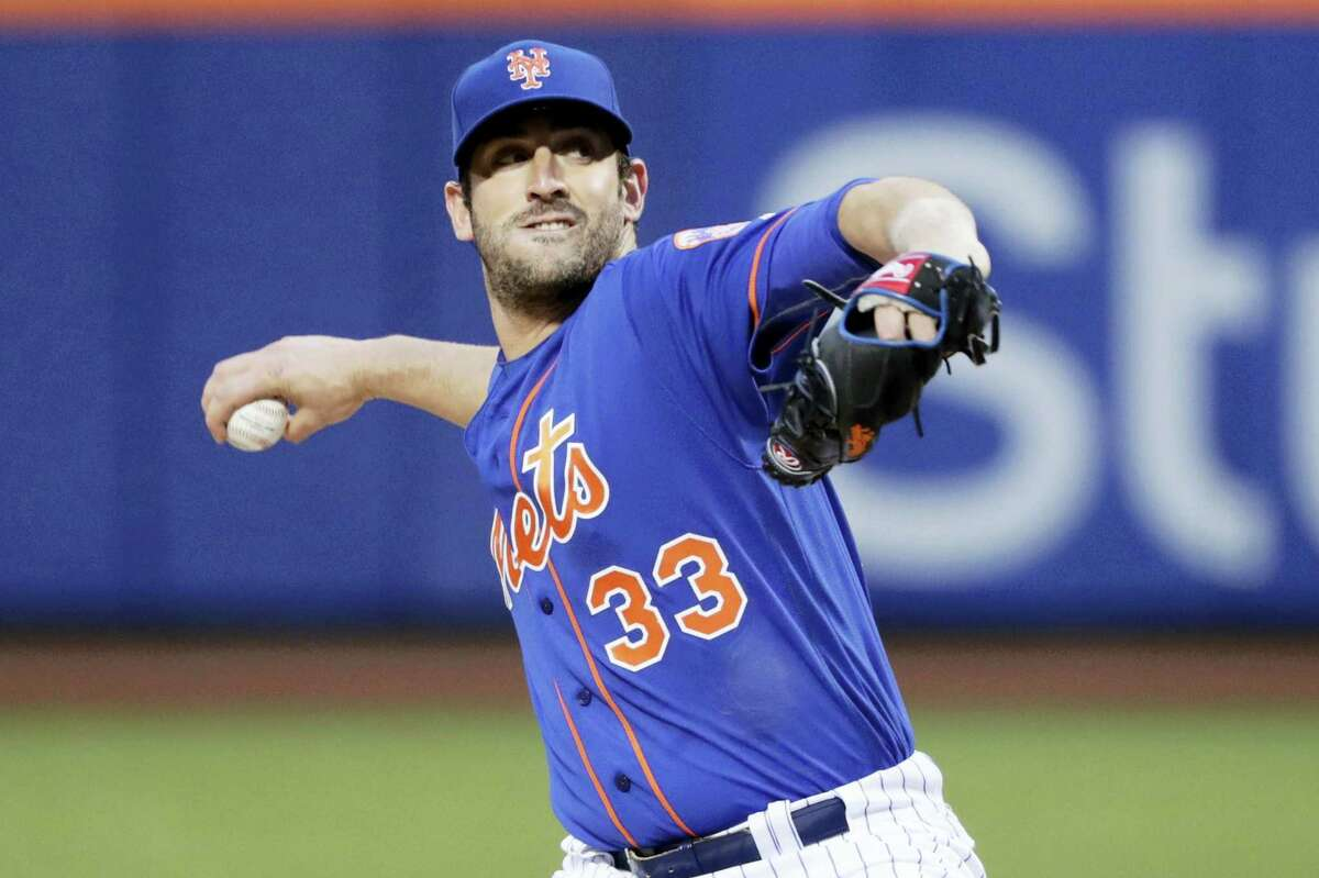 In a Friday, April 21, 2017 photo, New York Mets' Matt Harvey (33) delivers a pitch during the first inning of a baseball game against the Washington Nationals, in New York. The New York Mets have scratched Harvey for his scheduled start Sunday, May 7, 2017 against the Miami Marlins and suspended the right-hander three days for a violation of team rules.
