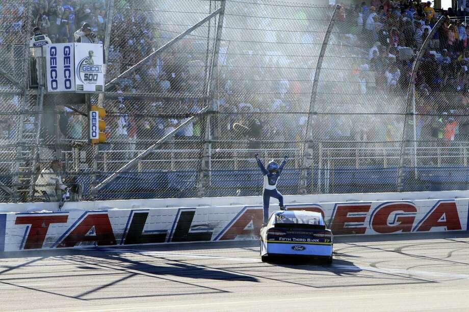 Ricky Stenhouse Jr. (17) celebrates after winning at Talladega Superspeedway on Sunday. Photo: Ron Sanders — The Associated Press  / Associated Press