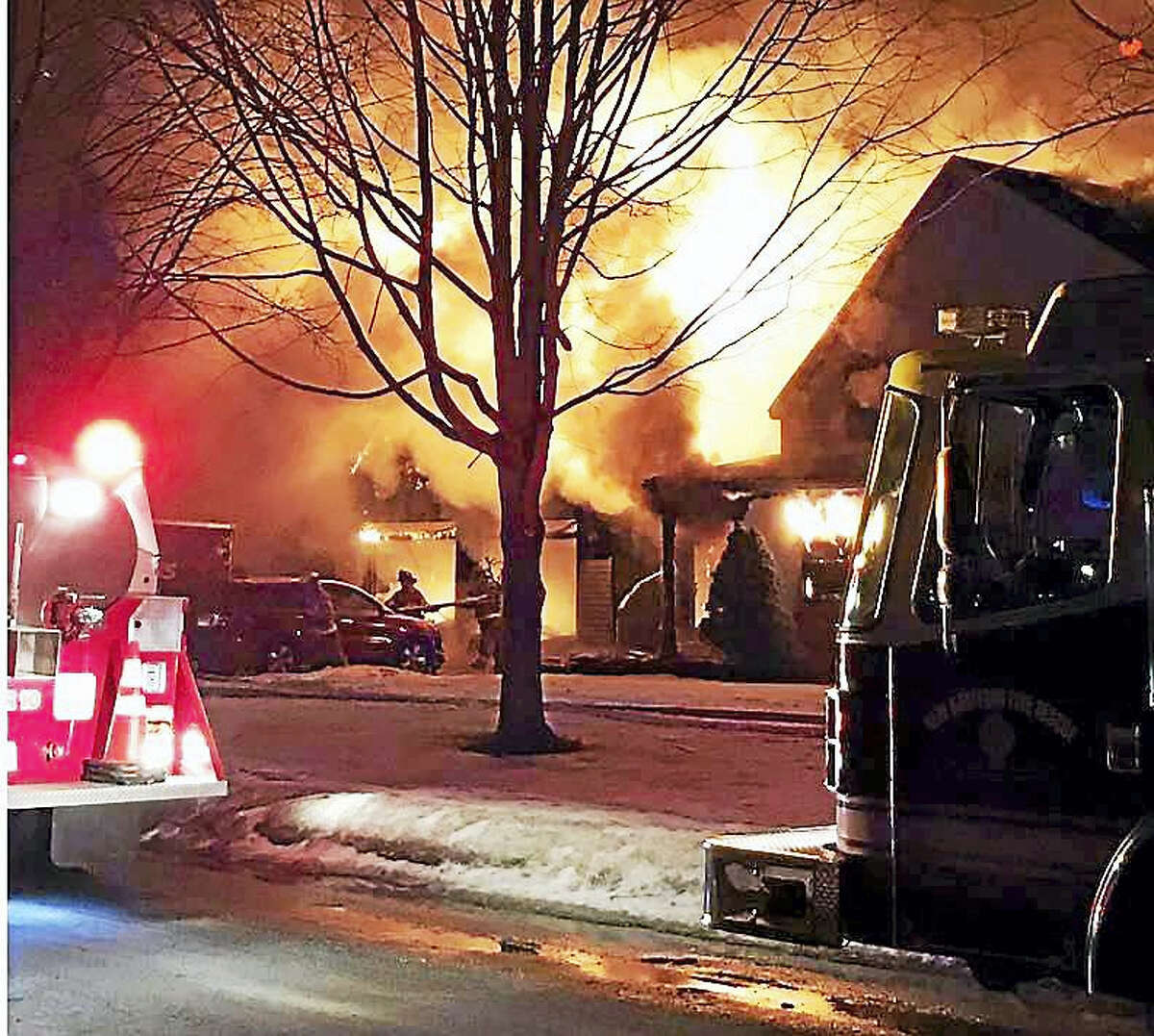 Crews from New Hartford and several other area departments battled a two-alarm blaze Wednesday night at a home on Arrowhead Drive.