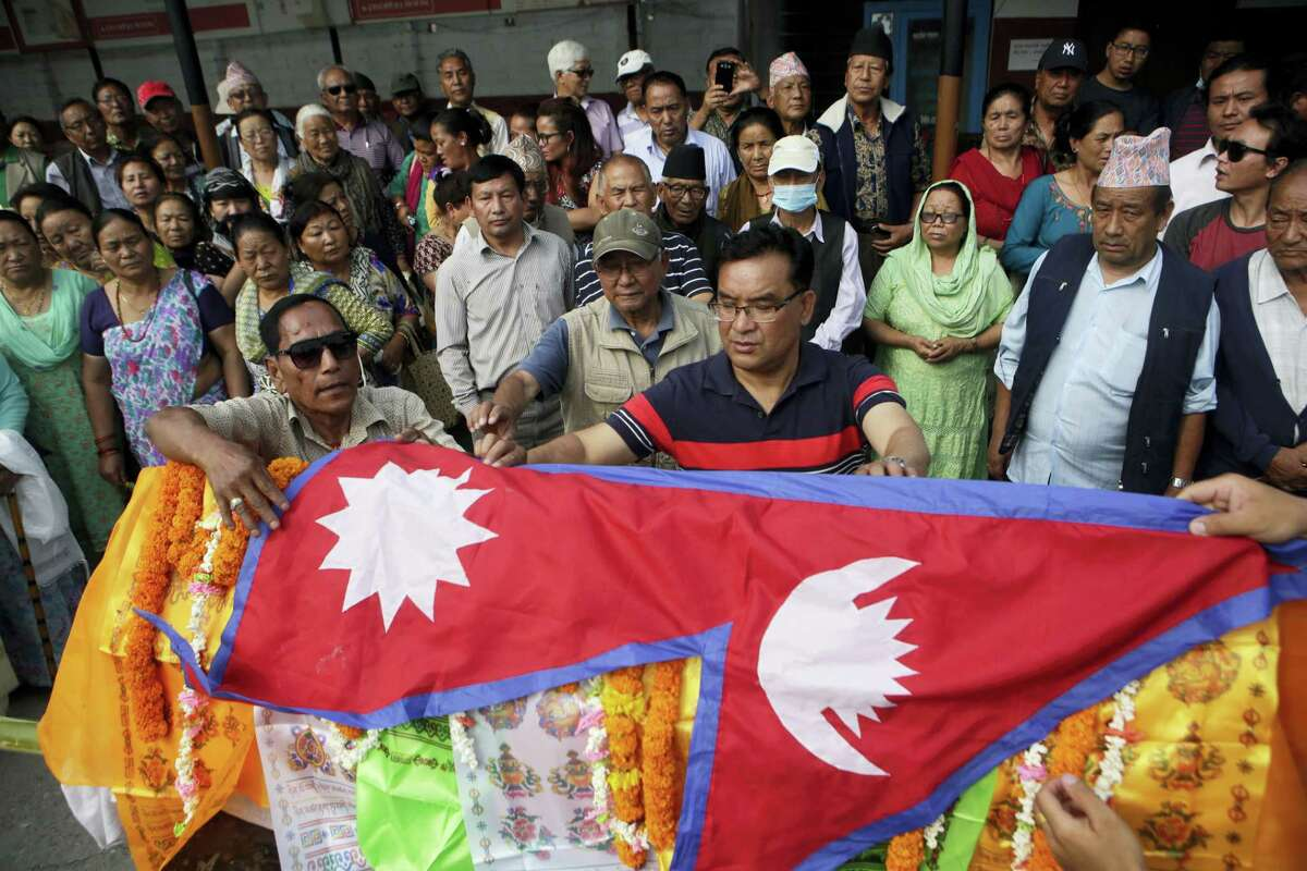 Family members of Nepalese climber Min Bahadur Sherchan put Nepalese flag on his deadbody during his funeral in Kathmandu, Nepal, Sunday. The 85-year-old Nepali man died while attempting to regain his title as the oldest person to climb Mount Everest, officials said. Sherchan died at the Everest base camp on Saturday evening.