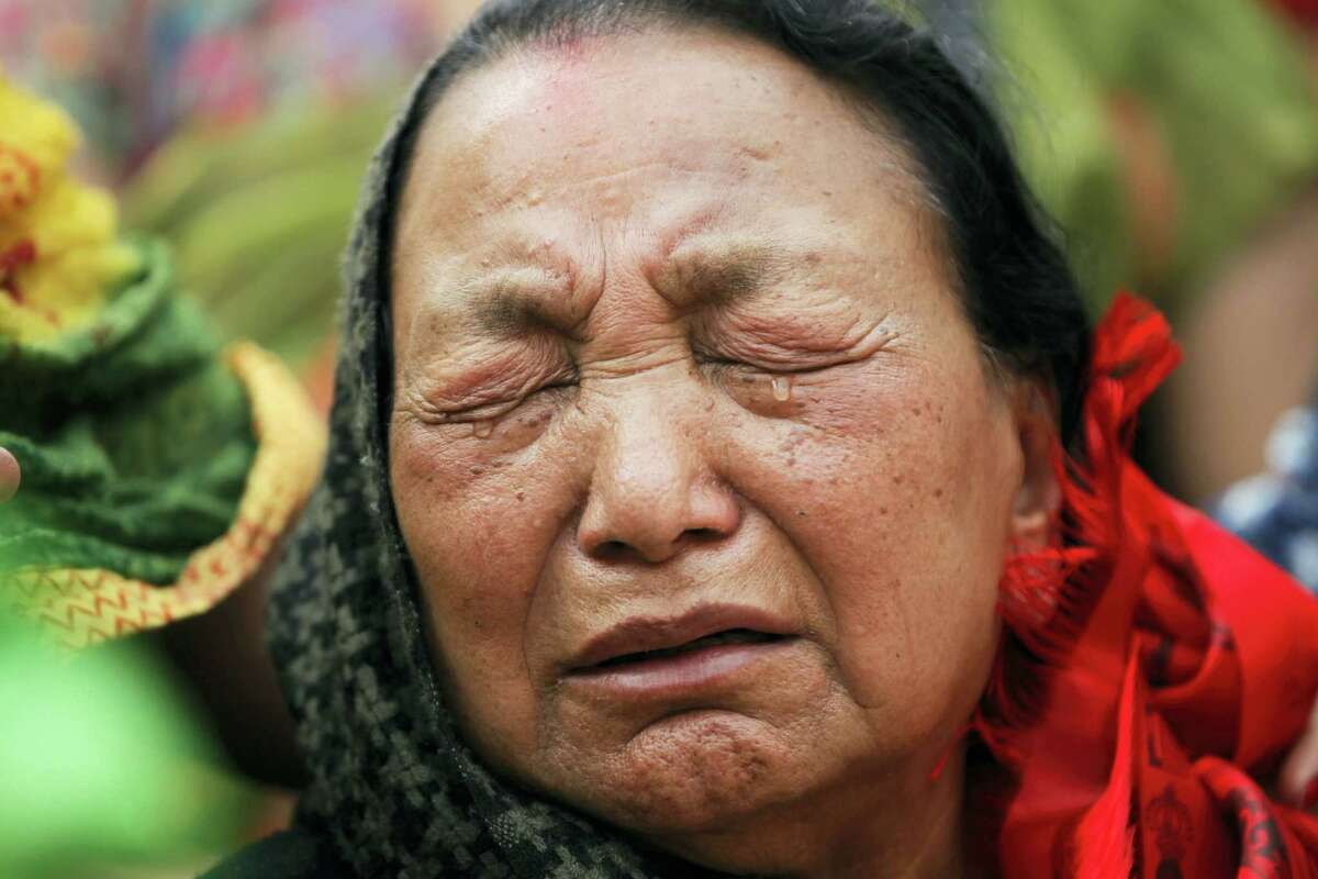 Purna Kumari Sherchan, wife of Nepalese climber Min Bahadur Sherchan cries during her husband's funeral in Kathmandu, Nepal on Sunday, May 7, 2017. The 85-year-old Nepali man died while attempting to regain his title as the oldest person to climb Mount Everest, officials said. Sherchan died at the Everest base camp on Saturday evening.