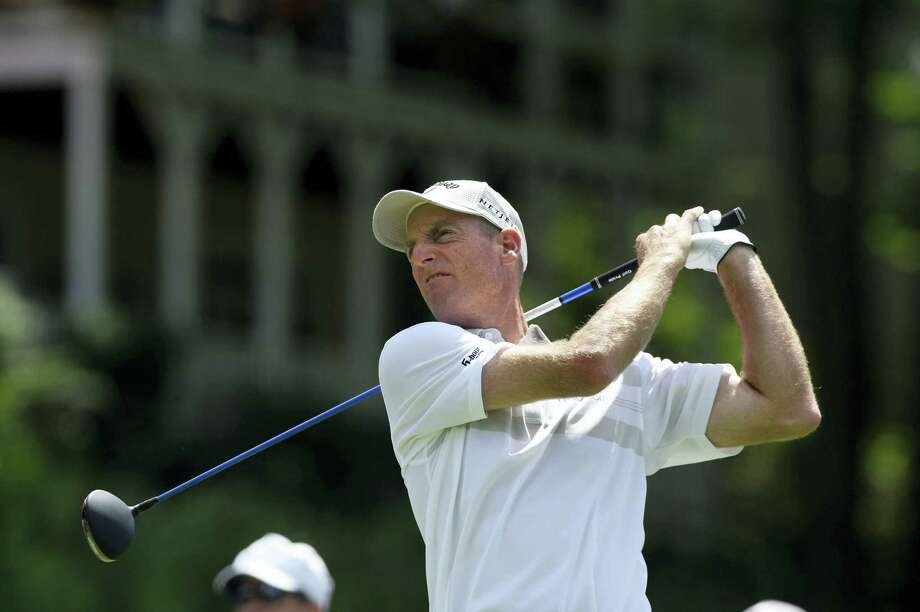 Jim Furyk watches his drive on the 18th hole on his way to shooting a PGA record 58 during the final round of the Travelers Championship golf tournament in Cromwell in 2016. Photo: Fred Beckham — AP File Photo / FR153656 AP