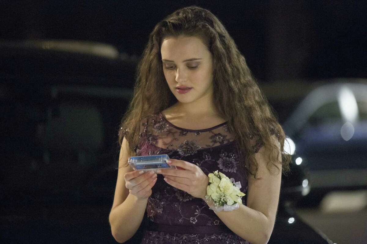 """This image released by Netflix shows Katherine Langford in a scene from the series """"13 Reasons Why,"""" about a teenager who commits suicide. The stomach-turning suicide scene has triggered criticism from some mental health advocates that it romanticizes suicide and even promoted many schools across the country to send warning letters to parents and guardians. The show's creators are unapologetic, saying their frank depiction of teen life needs to be 'unflinching and raw.'"""