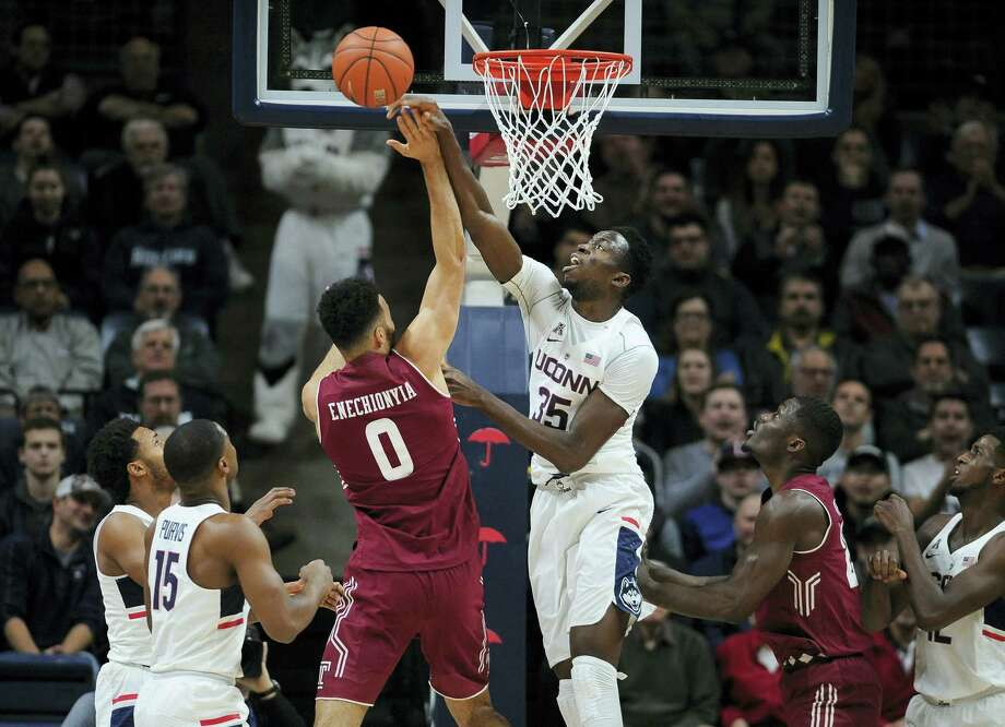 Connecticut's Amida Brimah blocks a shot by Temple's Obi Enechionyia, left, in the first half of an NCAA college basketball game, Wednesday, Jan. 11, 2017, in Storrs, Conn. (AP Photo/Jessica Hill) Photo: AP / AP2017