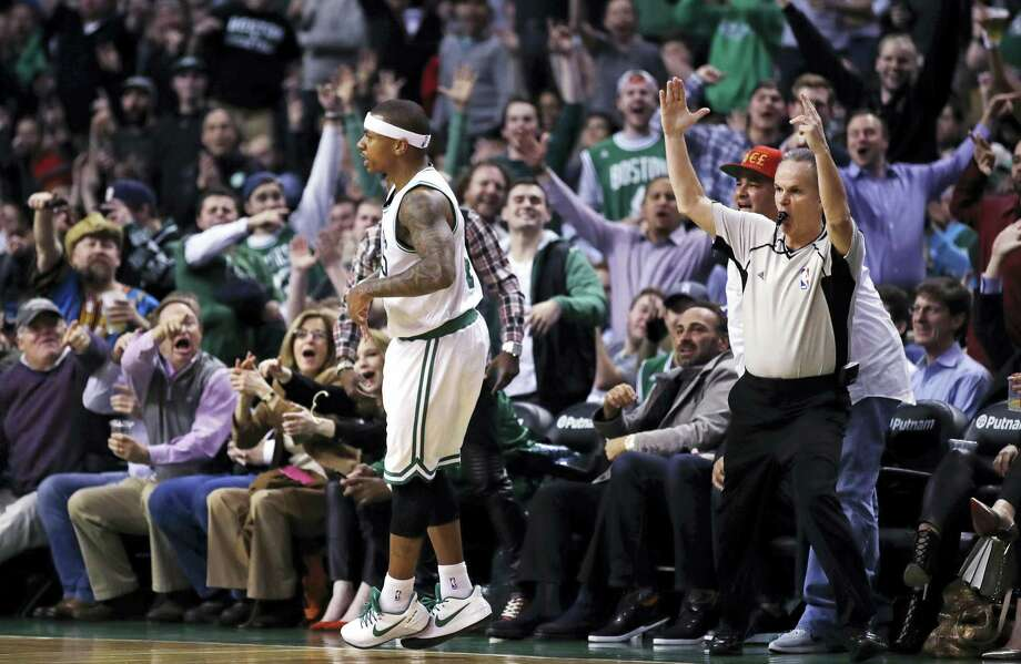Fans celebrate a 3-pointer by Boston Celtics guard Isaiah Thomas, center, during the second half of the team's NBA basketball game against the Washington Wizards in Boston, Wednesday, Jan. 11, 2017. Thomas had 38 points as the Celtics won 117-108. (AP Photo/Charles Krupa) Photo: AP / Copyright 2017 The Associated Press. All rights reserved.