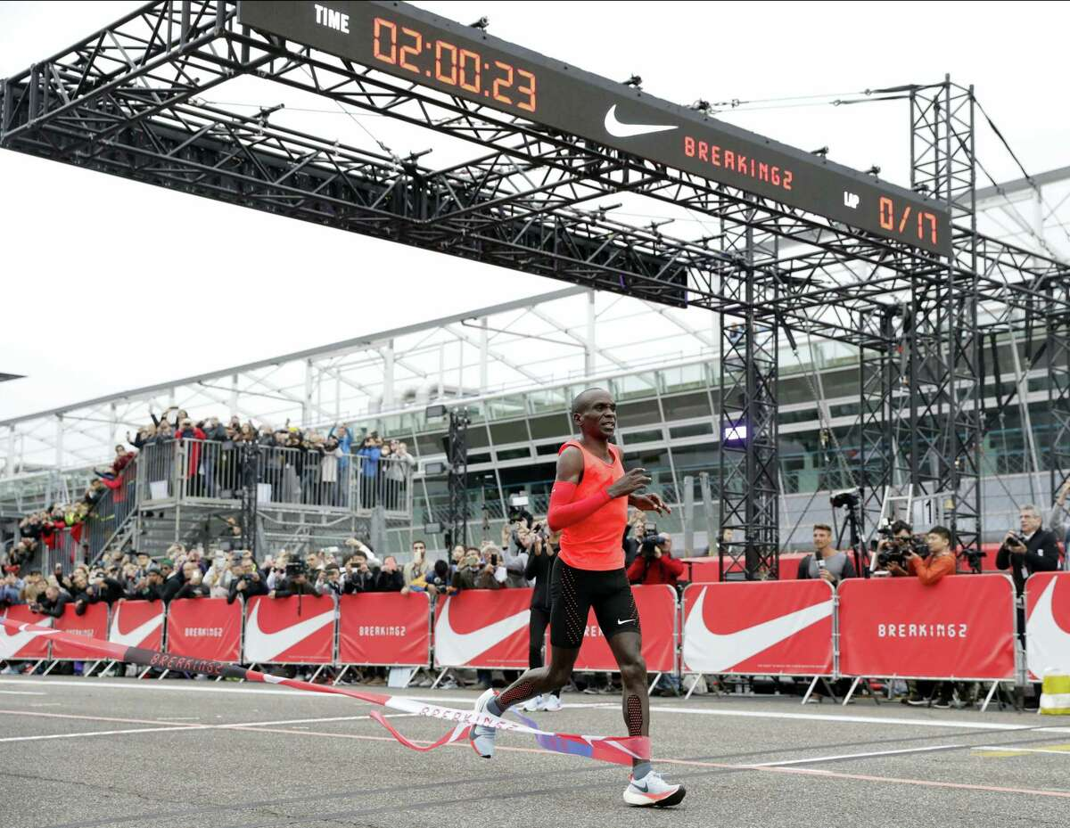 Olympic marathon champion Eliud Kipchoge crosses the finish line of a marathon race at the Monza Formula One racetrack in Italy on Saturday.