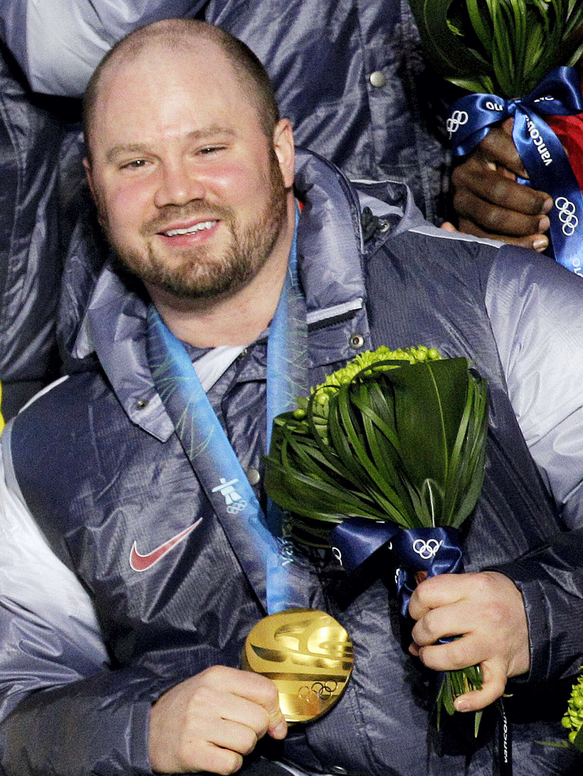Steven Holcomb poses with his gold medal in the men's four-man bobsled during the medal ceremony at the Vancouver 2010 Olympics in Whistler, British Columbia.