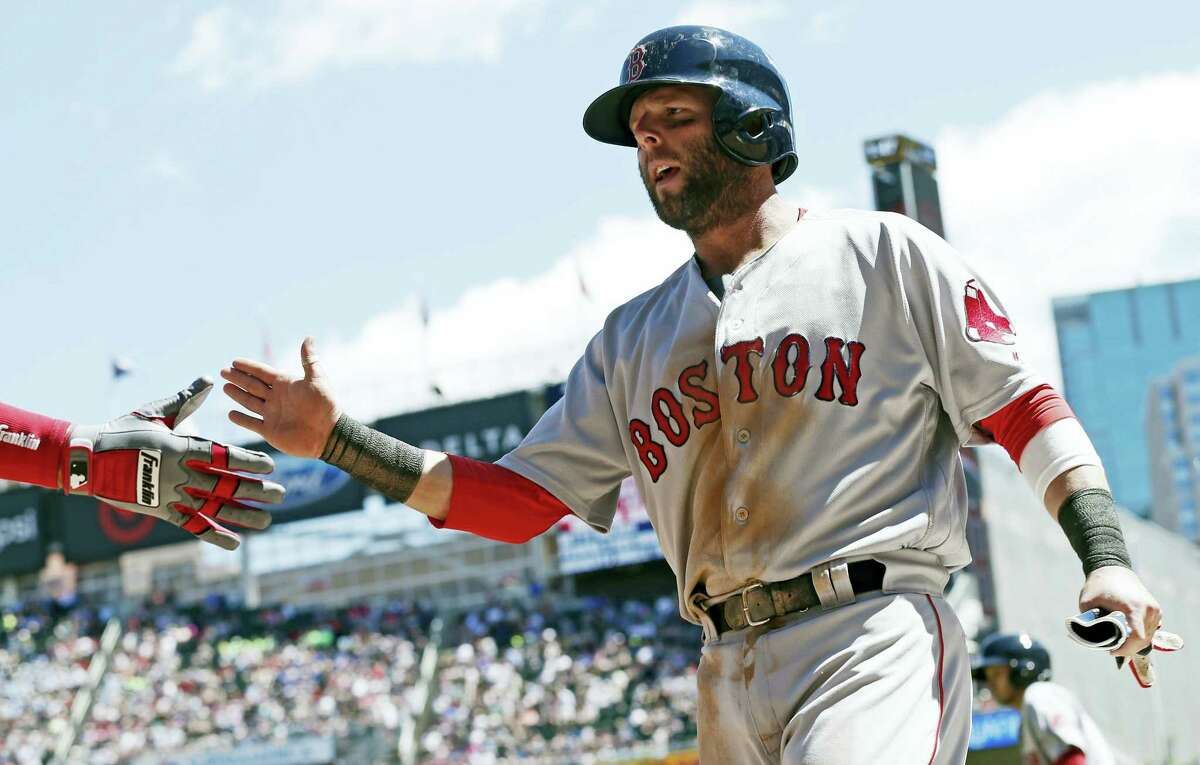 Dustin Pedroia is congratulated after scoring on a two-run double by Andrew Benintendi in the second inning Saturday.