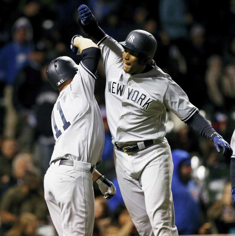 The Yankees' Aaron Hicks, right, celebrates with Brett Gardner after hitting a three-run home run Saturday. Photo: Nam Y. Huh — The Associated Press  / Copyright 2017 The Associated Press. All rights reserved.