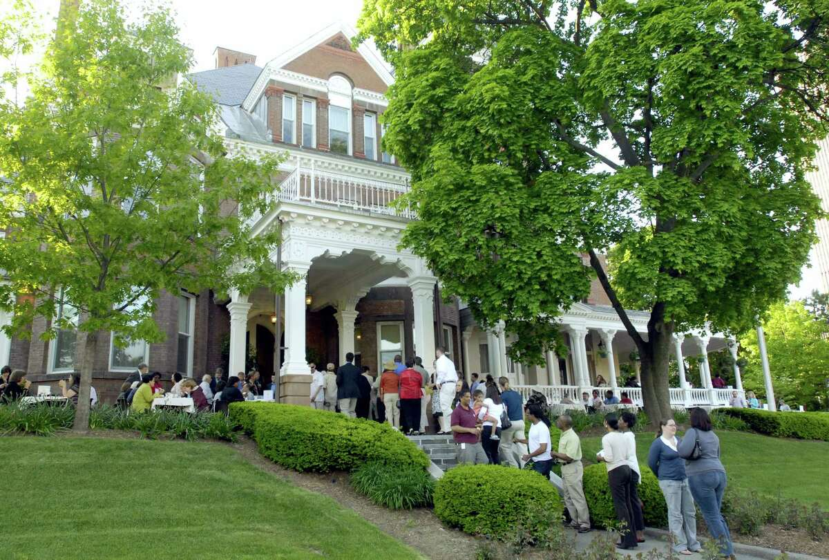 In this May 22, 2007 file photo, residents from the neighborhood gather for a cookout at the governor's residence in Albany, N.Y. New York Gov. Andrew Cuomo says spooky sounds keep him awake at night when he stays at the governor's mansion in Albany. The Democrat told a Long Island crowd Thursday, May 4, 2017, that during legislative sessions he spends evenings awake and unsettled by unexplained noises in the 161-year-old mansion near the Capitol building.