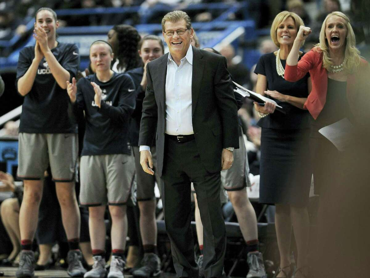 Connecticut head coach Geno Auriemma, center, and his team reacts in the first half of an NCAA college basketball game against South Florida on Jan. 10, 2017 in Hartford.