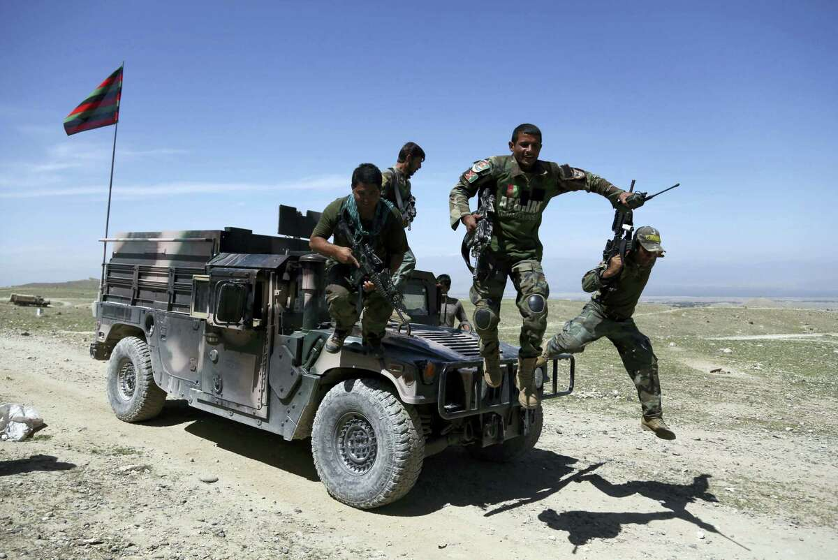 Afghan commandos arrive at Pandola village near the site of a U.S. bombing in the Achin district of Jalalabad, east of Kabul, Afghanistan.