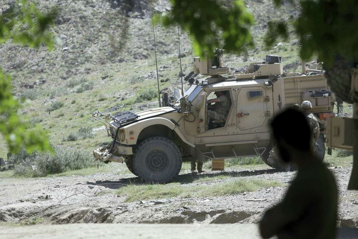 U.S. forces and Afghan commandos patrol in Asad Khil village near the site of a U.S. bombing in the Achin district of Jalalabad, east of Kabul, Afghanistan.